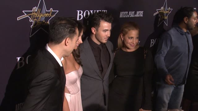 danielle deleasa and kevin jonas at the hollywood domino annual preoscar soiree presented by bovet 1822 at the sunset tower hotel on february 19 2015... - オスカーパーティー点の映像素材/bロール