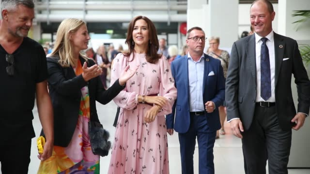 danish crown princess mary of denmark mary elizabeth donaldson wearing pink dress with belt is seen at ciff fair during the copenhagen fashion week... - königshaus stock-videos und b-roll-filmmaterial