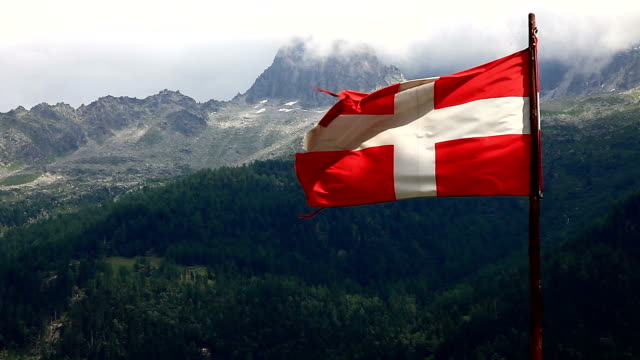 danish flag and mountain peak - all european flags stock videos and b-roll footage