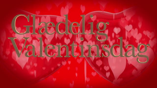 vídeos de stock, filmes e b-roll de frase do dia dinamarquês feliz dia dos namorados, glædelig valentinsdag com dois corações vermelhos 3d de espancamento e coração em movimento em forma de partículas são no fundo vermelho - símbolo conceitual