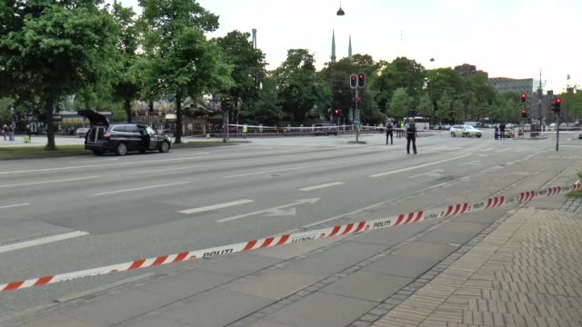 danish police officers block traffic on hc andersens boulevard in copenhagen near the tivoli amusement park after a man was shot by police after he... - terrorism bildbanksvideor och videomaterial från bakom kulisserna