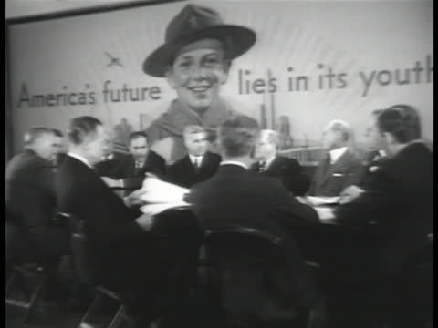 danish-born general motors president william s. knudsen talking, smiling . the boy scouts: boy scout board meeting. 'be prepared' poster. asian boys... - boy scout stock videos & royalty-free footage