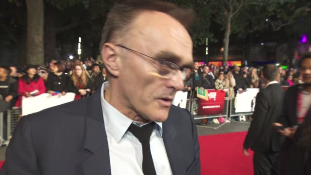 interview danny boyle on the film not being a biopic its a dramatisation not being the total truth working with talented people the drive to create... - odeon leicester square stock videos and b-roll footage