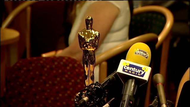 danny boyle returns to radcliffe social club after winning oscar; danny boyle puts oscar statuette on table, takes off his coat and press conference... - bafta mask stock videos & royalty-free footage