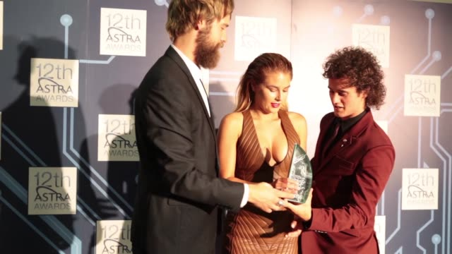 danny clayton, carissa walford and marty smiley, channel v accept their award for most outstanding music program at the 12th astra awards, sydney. - walford stock-videos und b-roll-filmmaterial