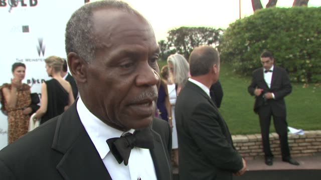 danny glover on the hiv/aids fight continuing, on food security. at the cannes film festival 2009: amfar red carpet at antibes . - retrovirus video stock e b–roll