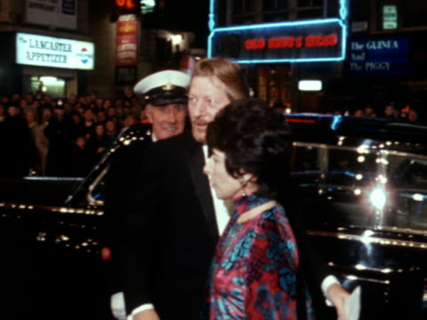 "danny kaye and his wife arrive at the gala screening of the film ""the madwoman of chaillot."" - film premiere stock videos & royalty-free footage"