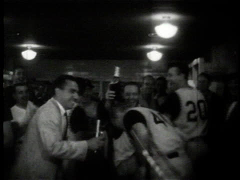 danny murtaugh getting champagne poured over his head by players during interview by press / united states - 1960 stock-videos und b-roll-filmmaterial