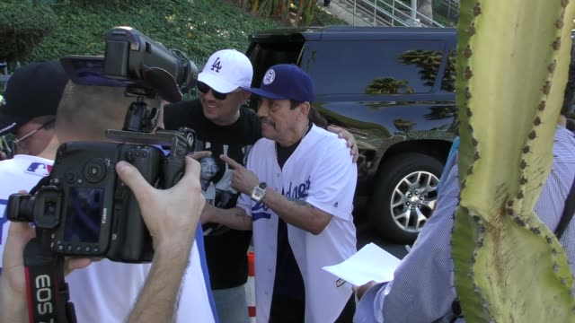 Danny Trejo signs for fans outside the LA Dodgers vs Milwaukee Brewers NLCS Game 5 Playoff in Los Angeles in Celebrity Sightings in Los Angeles