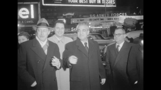 Danton Walker and Bob Weitman on sidewalk outside NYC movie premiere of The Eddie Cantor Story