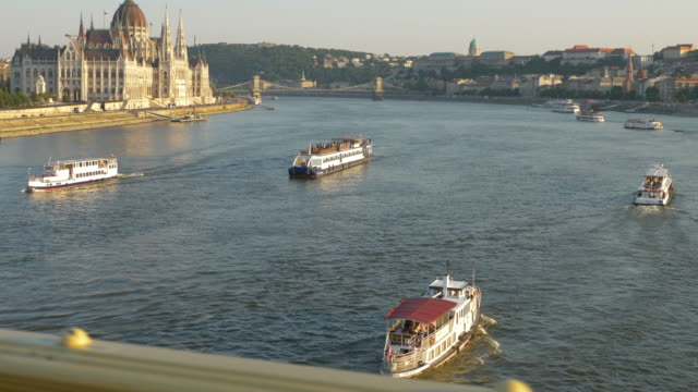 danube river and parliament cityscape in budapest - széchenyi chain bridge stock videos & royalty-free footage