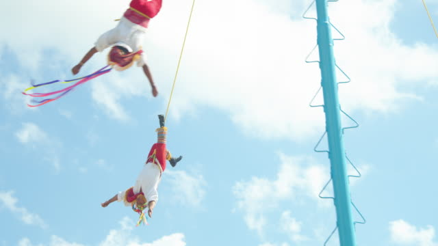 danza de los voladores. men upside down spinning hanging from a tall pole. mexico tradition - performer stock videos & royalty-free footage