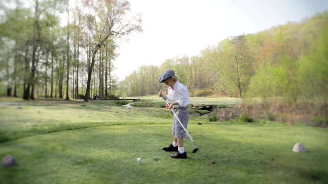 dapper boy playing golf - golf stock videos & royalty-free footage