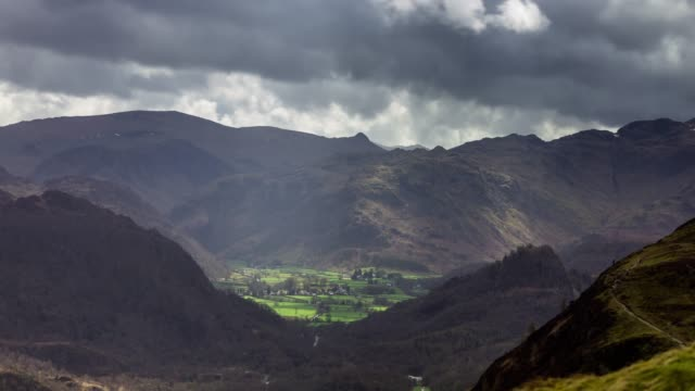 dappled light moving across cumbrian valley from slopes of catbells - time lapse - dappled light stock videos and b-roll footage