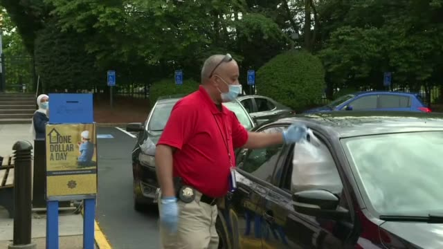 dar al-hijrah islamic center in falls church, virginia, distributes meals to people waiting in cars outside the mosque during ramadan amid the... - falls church stock videos & royalty-free footage