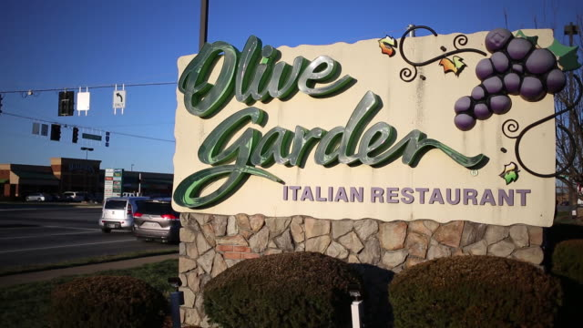 darden restaurants inc is scheduled to release earnings figures on march 19 signage is displayed outside a darden restaurants inc olive garden... - report document stock videos & royalty-free footage