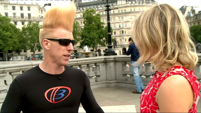 daredevil bello nock in london; england: london: trafalgar square: ext bello nock interview with reporter in shot sot nock performing three-finger... - bodyweight training stock videos & royalty-free footage