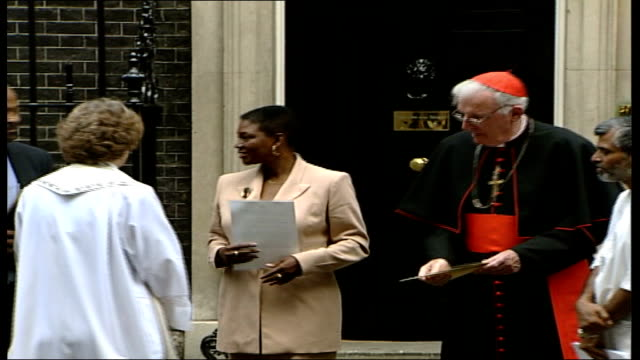 demonstrators across the world demand action; westminster: downing street: cardinal cormac murphy-o'connor along with other faith leaders zoom in... - cormac murphy o'connor stock videos & royalty-free footage