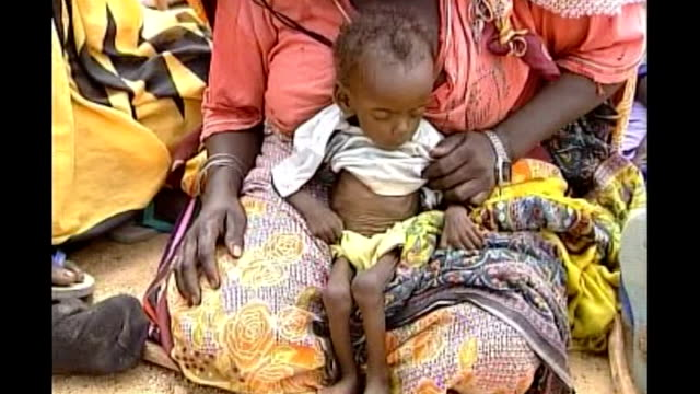 international criminal court accuses sudan government of war crimes r16080402 darfur rows of tents in refugee camp malnourished baby on mother's lap... - スーダン点の映像素材/bロール