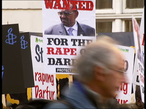 Protests held in London at governmentcondoned rapes Various views of placards and campaigners/ Sign 'Embassy of the Republic of the Sudan/ Backviews...