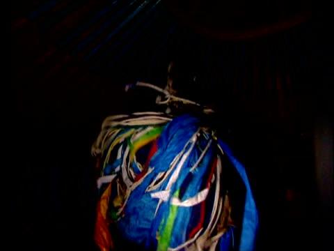 vidéos et rushes de darhad shaman dances vigorously wearing brightly coloured cloak darhad valley mongolia - mongolie indépendante