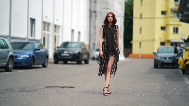 dariana cerciu wears a striped sleeveless dress with black lace black heels shoes during feeric fashion week 2018 on july 22 2018 in sibiu romania - sleeveless dress stock videos and b-roll footage