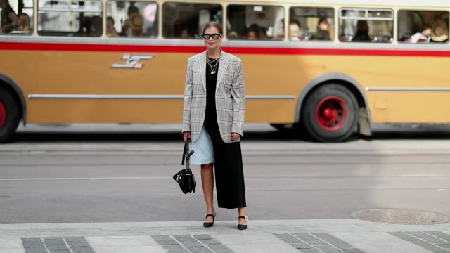 Darja Barannik wearing a checked blazer is seen outside the 'Pia Tjelta' show during Oslo Runway SS19 on August 15 2018 in Oslo Norway
