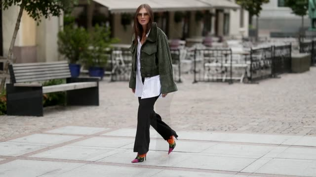 Darja Barannik wearing black pants green jacket and a white button shirt is seen outside the 'Moire' show during Oslo Runway SS19 on August 15 2018...