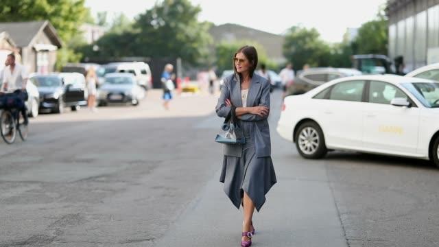 Darja Barannik wearing grey midi skirt blazer is seen outside Ganni during the Copenhagen Fashion Week Spring/Summer 2019 on August 9 2018 in...