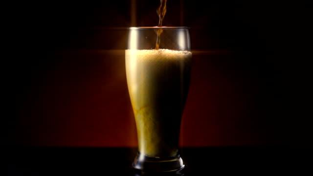 dark amber beer pour wide star filter - 茶色背景点の映像素材/bロール