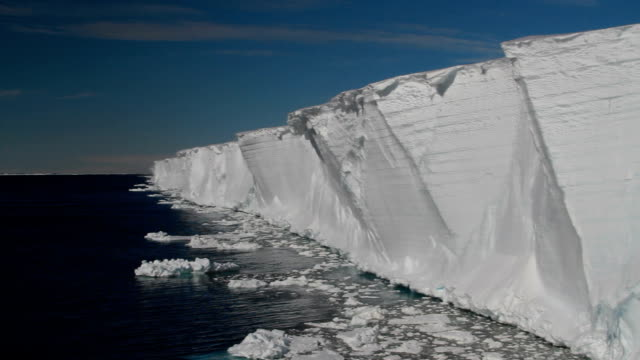 pan dark blue ocean to ice shelf, antarctica - shelf stock videos and b-roll footage