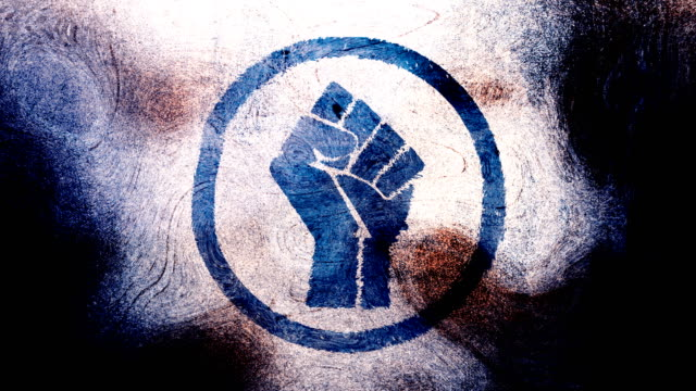 Dark blue raised fist symbol on high contrasted grungy and dirty, animated, distressed and smudged 4k video background with swirls and frame by frame motion feel with street style for the concepts of solidarity,support,human rights,worker rights,strength