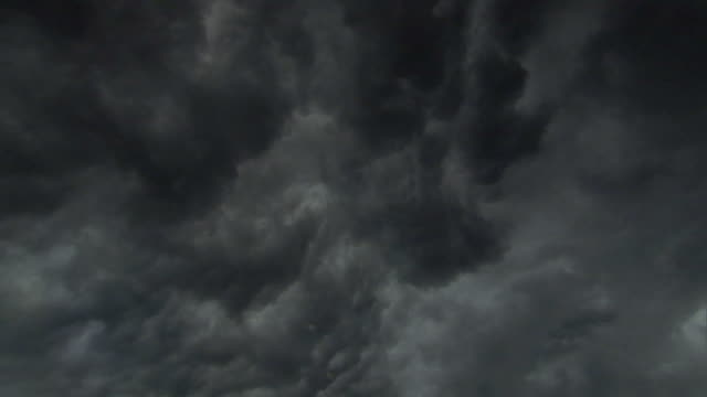 dark brooding storm clouds gather in sky, madagascar - low angle view stock videos & royalty-free footage