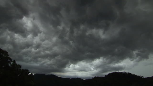 dark brooding storm clouds gather in sky, madagascar - dark stock videos & royalty-free footage