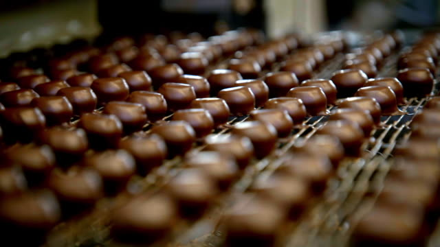 dark chocolate pieces being coated in liquid white chocolate - in a row stock videos & royalty-free footage
