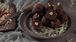 Dark chocolate truffles with hazelnuts