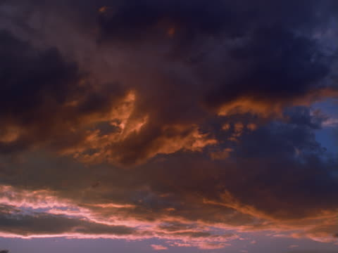 dark cirrus and altocumulus clouds at sunset - altocumulus stock videos and b-roll footage