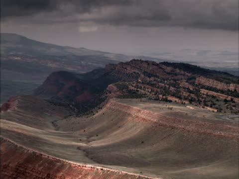 dark clouds cast long shadows on sandstone cliffs. - sandstone stock videos & royalty-free footage