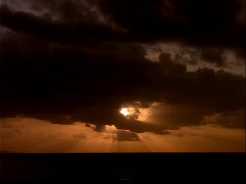 dark clouds covering sunset - murmursofearth点の映像素材/bロール