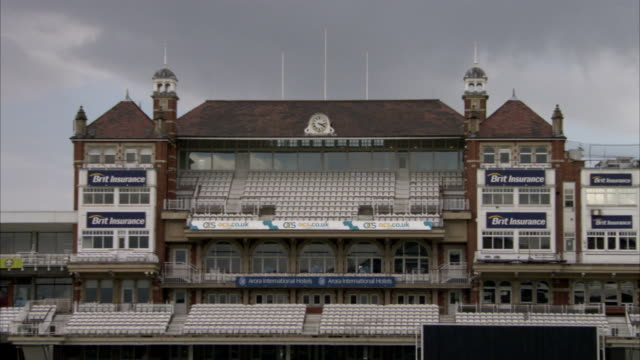 dark clouds hang over the pavilion at the oval cricket ground. available in hd. - oval kennington stock videos & royalty-free footage