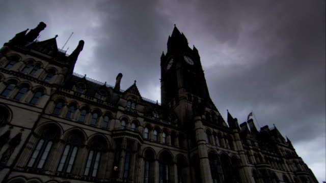Dark clouds loom over Manchester Town Hall. Available in HD.