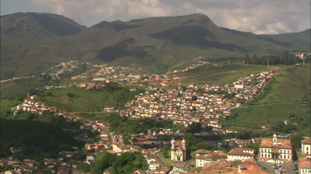 dark clouds move over clusters of houses in the hillside community of ouro preto, brazil. - south america stock videos & royalty-free footage