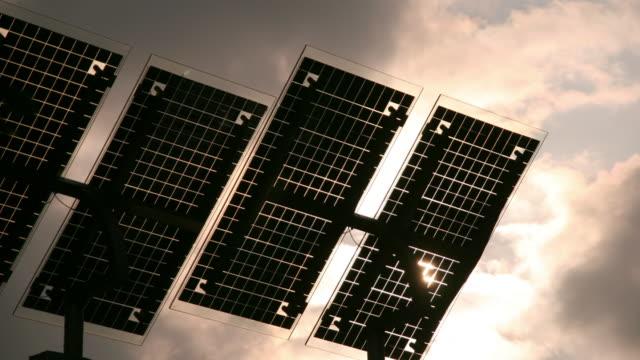 dark clouds move over solar panels near duisburg, germany. - ルール渓谷点の映像素材/bロール