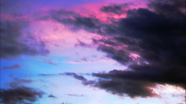 dark clouds moving in purple sky - purple stock videos & royalty-free footage