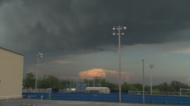 Dark clouds over an athletic field