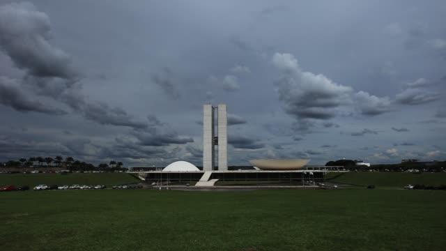 dark clouds over brazilian national congress - oscar niemeyer stock videos and b-roll footage