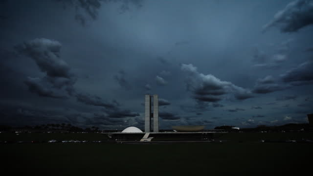 dark clouds over brazilian national congress - brasilia stock videos and b-roll footage
