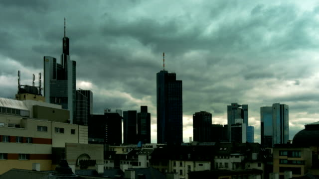 pan t/l dark clouds over frankfurt skyline (4k/uhd to hd) - main tower stock videos and b-roll footage