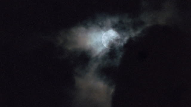 dark clouds pass over a full moon. - film stock videos & royalty-free footage