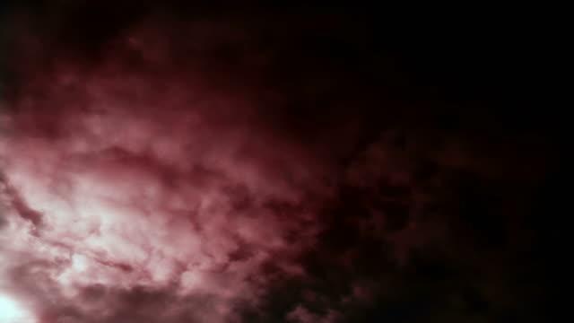 dark clouds roil in a stormy time lapse sky (loop). - digital enhancement stock videos & royalty-free footage
